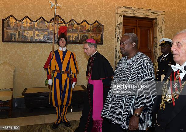 President of Ghana John Dramani Mahama flanked by Prefect of the Pontifical House and former personal secretary of Pope Benedict XVI Georg Ganswein...