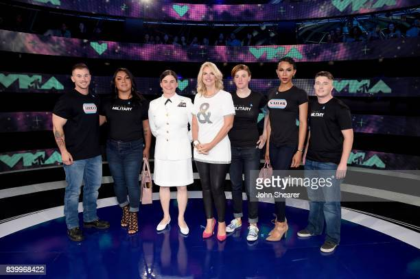 President of GLAAD Sarah Kate Ellis and transgender military members attend the 2017 MTV Video Music Awards at The Forum on August 27 2017 in...