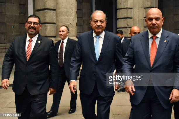 President of Grupo CARSO Carlos Slim Helu is seen walks during a press conference of VII Symposium of Historic Centers at Palacio de Mineria on May...
