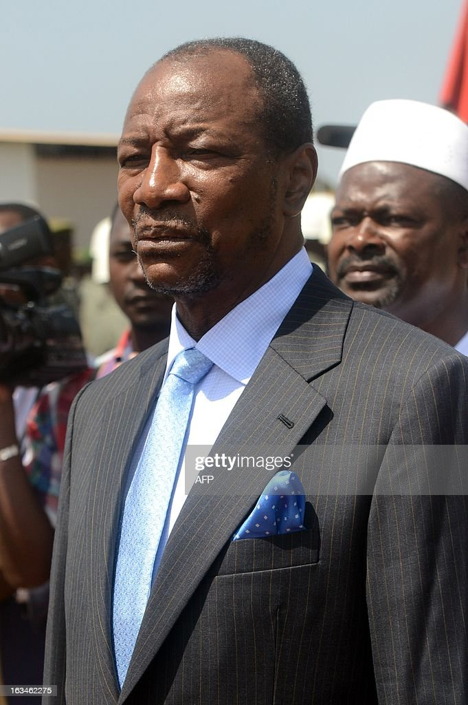President of Guinea Alpha Conde looks on at the Conakry airport, on March 10,2013, before meeting his counterparts from Ivory Coast, Liberia and Sierra Leone, as Guinea battles unrest linked to legislative elections in May.