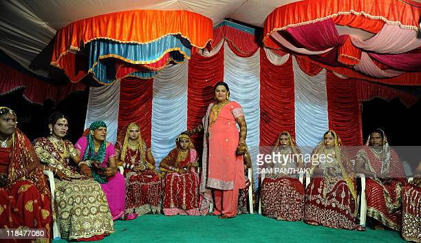 President of Gujarat State Kinnar Association Sonia De blesses Eunuchs during their wedding reception in Ahmedabad on July 12 2009 In the presence of...