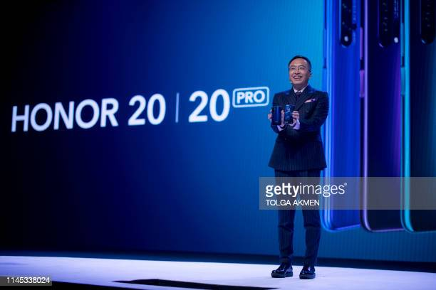 President of Honor a subbrand of Chinese telecommunications company Huawei George Zhao Honor 20 Pro smartphone during his keynote speech at an event...