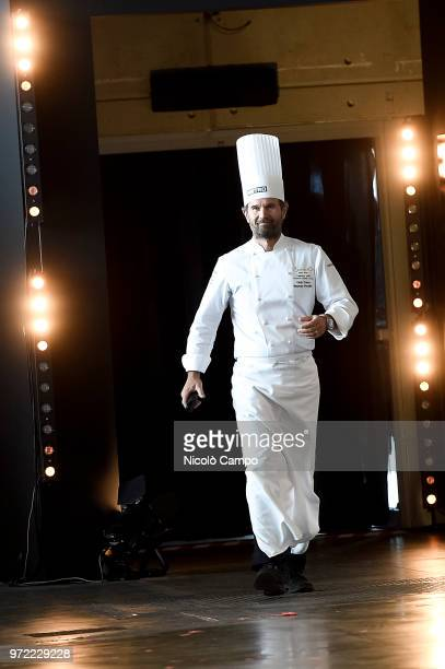 President of honour Carlo Cracco greets the audience during the Europe 2018 Bocuse d'Or International culinary competition Best ten teams will access...
