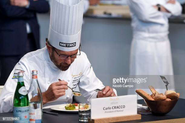 President of honour Carlo Cracco tastes a dish during the Europe 2018 Bocuse d'Or International culinary competition Best ten teams will access to...