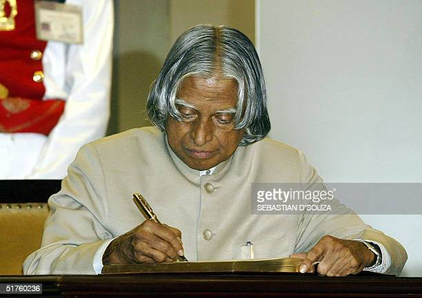President of India Dr APJAbdul Kalam writes in the suggestion book at the inauguration of the Reserve Bank of India Monetary Museum in Bombay18...
