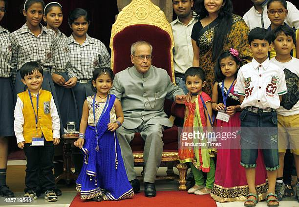 President of India Pranab Mukherjee meeting the children on the auspicious occasion of Raksha Bandhan at Rashtrapati Bhavan on August 29 2015 in New...