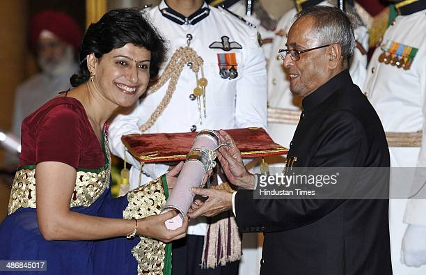 President of India Pranab Mukherjee presents Padma Bhushan award to the women cricketer Anjum Chopra during the Padma Awards 2014 at a Civil...