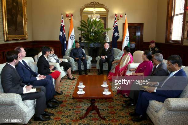 President of India, Ram Nath Kovind, center left, talks with Australia's Governor-General, Sir Peter Cosgrove, center right, during a visit to...