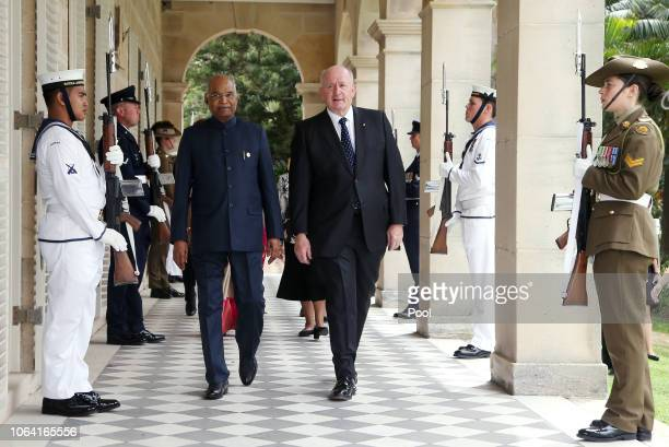 President of India, Ram Nath Kovind, center left, walks with Australia's Governor-General Sir Peter Cosgrove, center right, during a visit to...