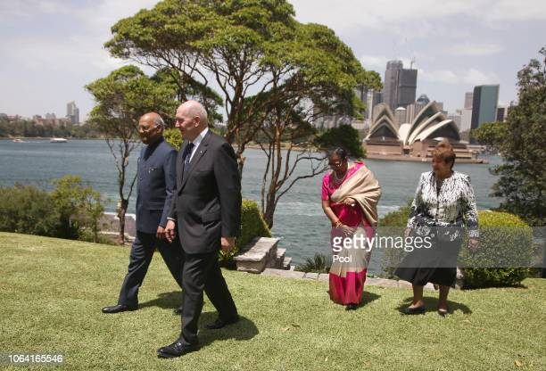 President of India Ram Nath Kovind left and his wife Savita second right walk with Australia's GovernorGeneral Sir Peter Cosgrove second left and his...