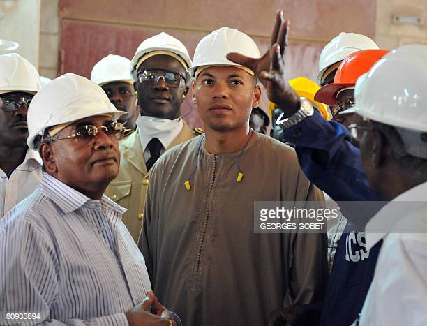 President of Indian Farmers Fertiliser Cooperative Uday Shankar Awasthi and Karim Wade consultant and son of Sengal's President Abdoulaye Wade listen...