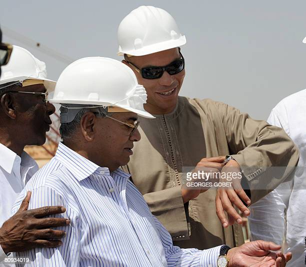 President of Indian Farmers Fertiliser Cooperative Uday Shankar Awasthi and Karim Wade consultant and son of Sengal's President Abdoulaye Wade check...