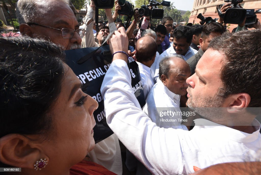 President of Indian National Congress and Lok Sabha MP Rahul Gandhi and other Lok Sabha MPs during Congress Party`s standing protest against Modi...