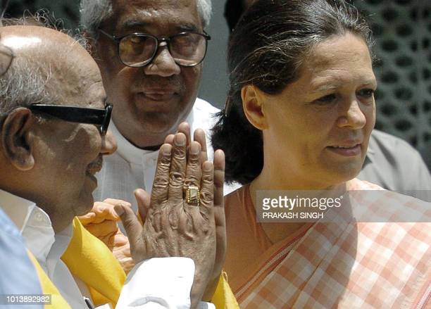 President of India's Congress Party Sonia Gandhi looks on as Dravida Munntra Kazhagam party leader MKarunanidhi greets her after a meeting in New...