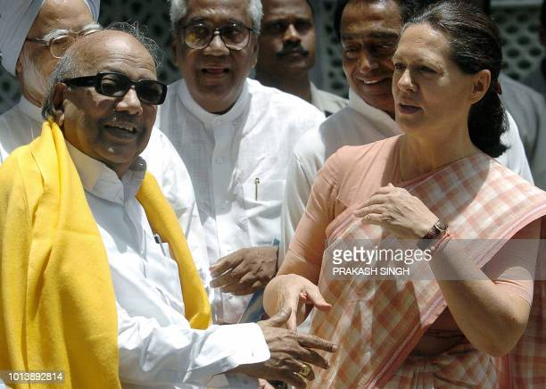 President of India's Congress Party Sonia Gandhi talks with Dravida Munntra Kazhagam party leader MKarunanidhi after a meeting in New Delhi 16 May...
