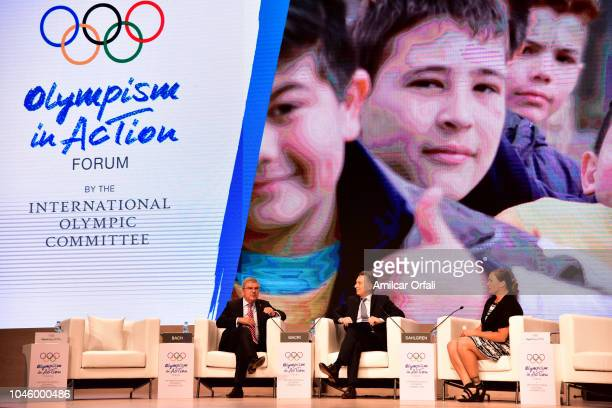 President of IOC Thomas Bach, President of Argentina Mauricio Macri and Argentine athlete Jennifer Dahlgren talk during the opening day of the...