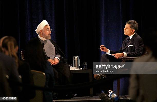 President of Iran Hassan Rouhani speaks with moderator and journalist Fareed Zakaria at the New York Hilton Midtown on September 24 2014 in New York...