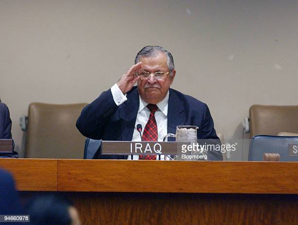 President of Iraq Jalal Talabani salutes audience members prior to a highlevel panel discussion on Iraq at the United Nations in New York September...
