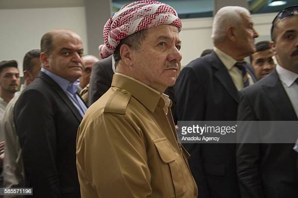President of Iraqi Kurdish Regional Government Masoud Barzani visits an exhibition during an event held for 2nd anniversary of Daesh massacre on...