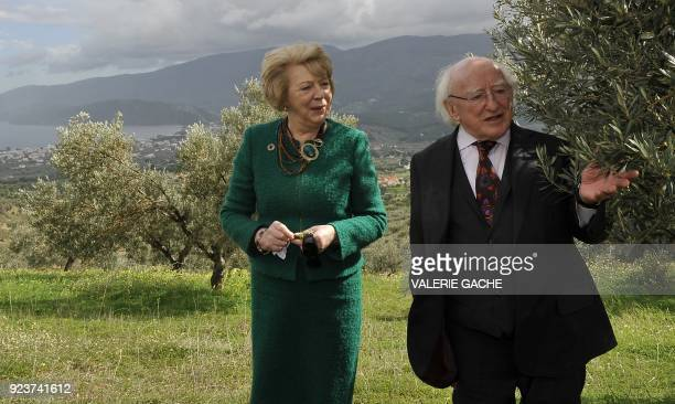 President of Ireland Michael Higgins and his wife Sabina visit an olive grove at Galataki village near Corinth during his official visit to Greece on...