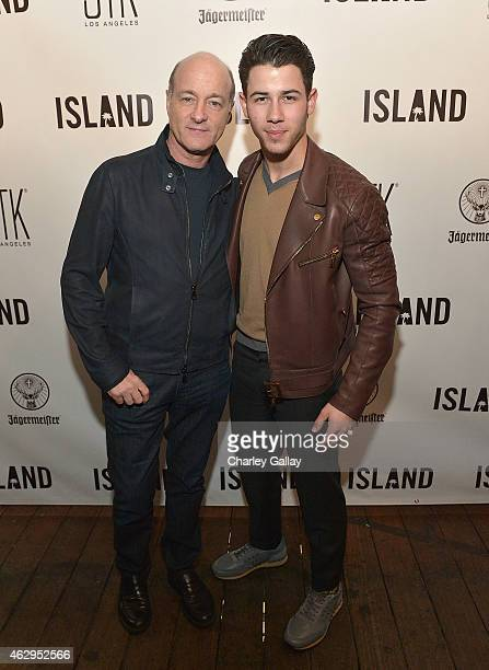 President of Island Records David Massey and Island recording artist Nick Jonas attend Island Records PreGrammy Party Hosted By President David...