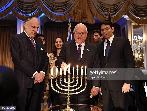 President of Israel Reuven Rivlin , Israeli UN Ambassador Danny Danon and President of the World Jewish Congress Ronald S. Lauder light the menorah....