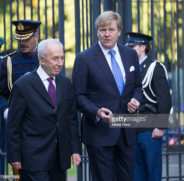President of Israel Shimon Peres and King Willem-Alexander of The Netherlands meet at Noordeinde Palace on October 1, 2013 in The Hague, Netherlands.
