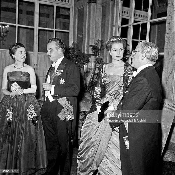 President of Italian Republic Giovanni Gronchi and his wife Carla Bissatini talking with Rainier III Prince of Monaco and his wife American actress...