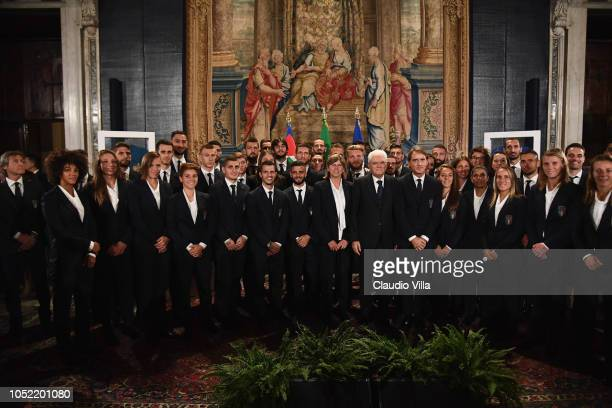 President of Italy Sergio Mattarella poses with Italy Men and Women players and coaches on October 15, 2018 in Rome, Italy.