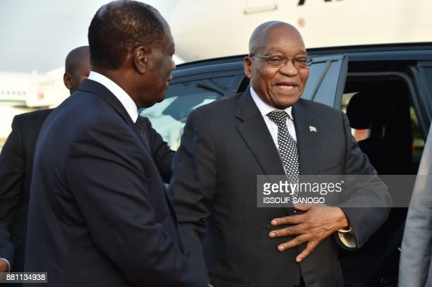President of Ivory Coast Alassane Ouattara welcomes president of South Africa Jacob Zuma upon his arrival at the Felix Houphouet Boigny airport in...