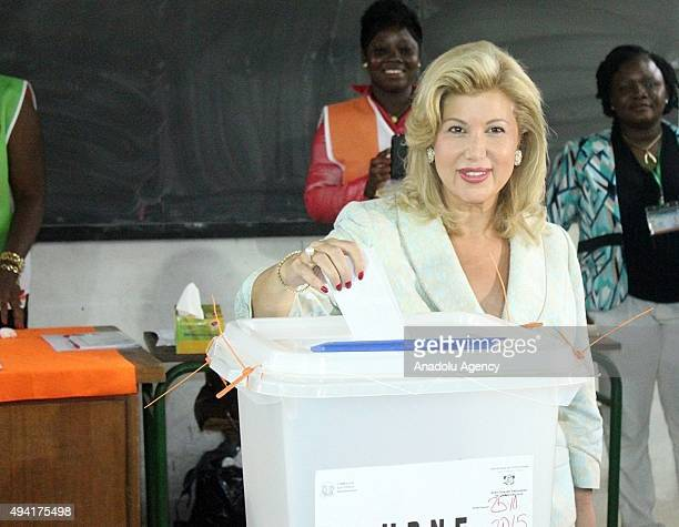 President of Ivory Coast Alassane Ouattara's wife Dominique Folloroux-Ouattara casts her vote in Saint Marry High School during the presidential...
