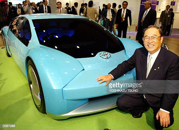 President of Japanese auto giant Toyota Motor Fujio Cho displays a concept model of a fourseater sports vehicle called 'FineS' equipped with a...