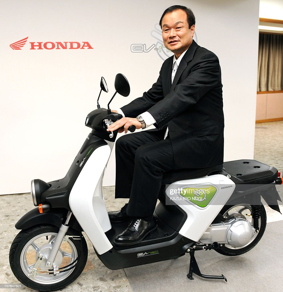 President Of Japanese Auto Maker Honda Motor Takanobu Ito Poses With The Companys EV