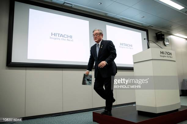 President of Japanese company Hitachi Toshiaki Higashihara leaves at the end of a press conference at the companys headquarters in Tokyo on January...