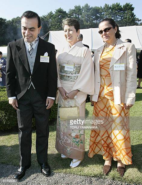 President of Japan's auto giant Nissan Motor Carlos Ghosn and his wife Rita share a light moment with an unidentified Japanese woman clad in kimono...