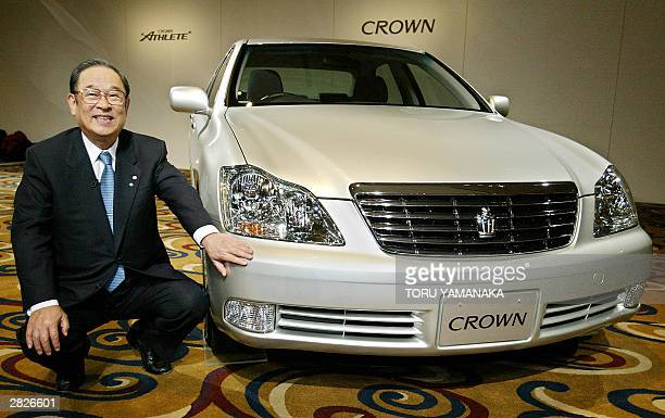 President of Japan's auto giant Toyota Motor Corporation Fujio Cho smiles as he sits beside its fully modelchanged flagship sedan 'Crown' in Tokyo 22...