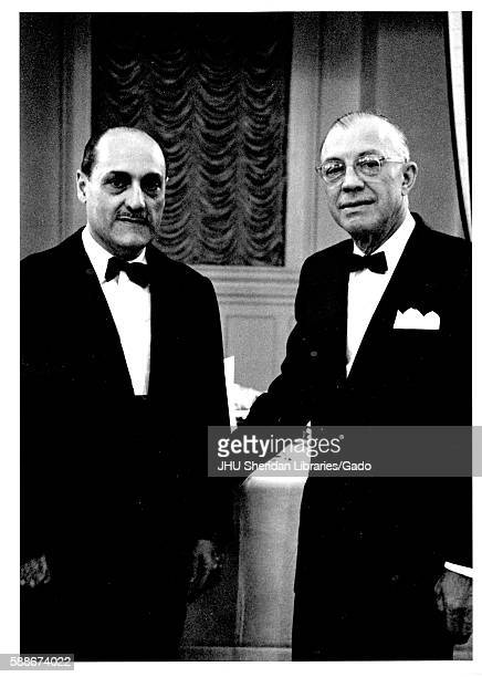 President of Johns Hopkins Univeristy Milton Stover Eisenhower shakes hands with President of Mexico Adolfo Lopez Mateos at Johns Hopkins...