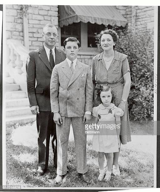 President of Kansas State College Milton Eisenhower brother of General of the Army Dwight D Eisenhower poses with his family outside their home in...
