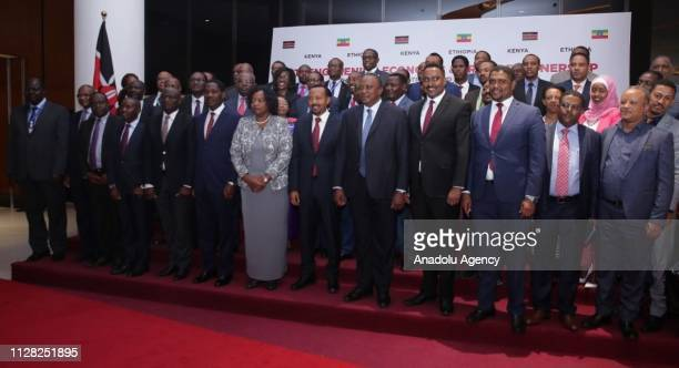 President of Kenya Uhuru Kenyatta and Ethiopian Prime Minister Abiy Ahmed pose for a photo with other participants after attending the Kenya Ethiopia...