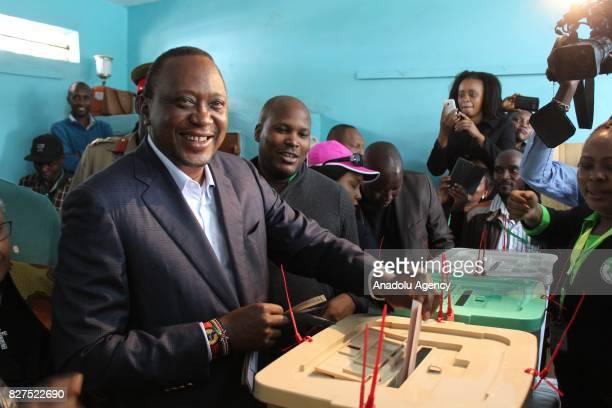 President of Kenya Uhuru Kenyatta casts his vote during the general elections at the Mutomo Primary School polling station in Gatundu Neighborhood of...