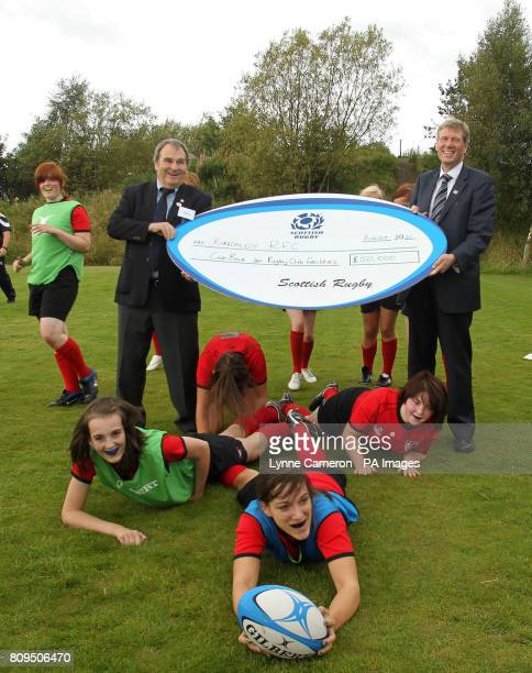 President of Kickcaldy Rugby Club Don Burns Kenny MacAskill Justice Secretary with Rachel Gould from Fife at the presentation of a cheque for 550k...
