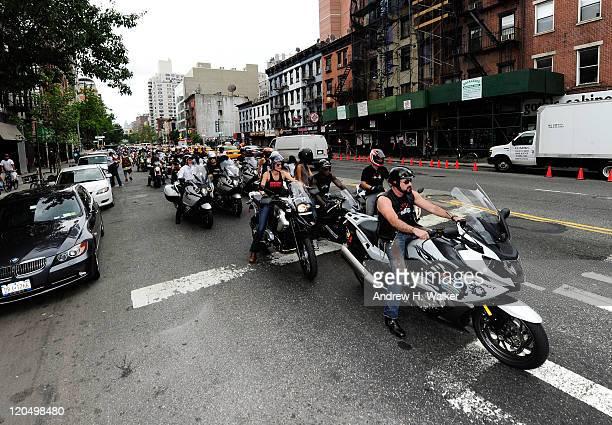 President of Kiehl's USA Chris Salgardo Tricia Helfer Tyson Beckford and MarkPaul Gosselaar arrive on a BMW motorcycle at Kiehl's LifeRide for amfAR...