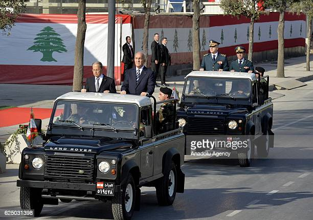 President of Lebanon Michel Aoun salutes people over a ceremonial vehicle during the 73rd Lebanese Independence Day ceremonies commemorating the...