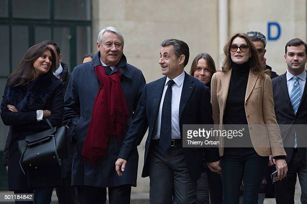 President of Les Republicains party Nicolas Sarkozy and his wife Carla Bruni Sarkozy arrive at a polling station Lycee la Fontaine for the second...