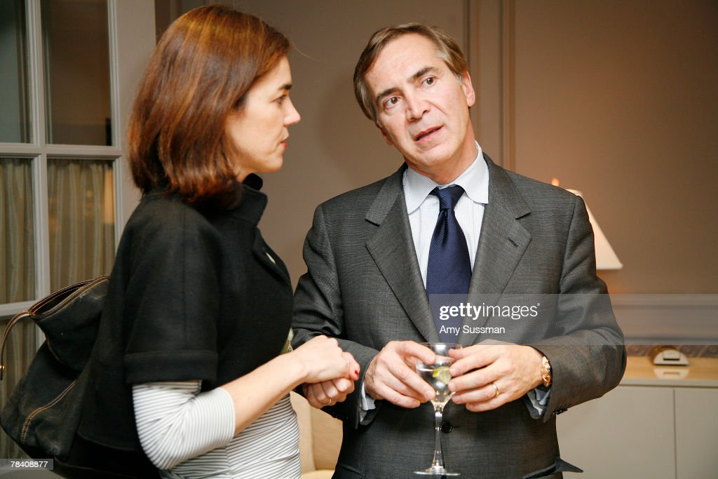 President of Leviev Thierry Chaunu talks to guest at the Leviev Diamonds and Elite Traveler holiday cocktail party at Leviev Diamonds December 11, 2007 in New York City.