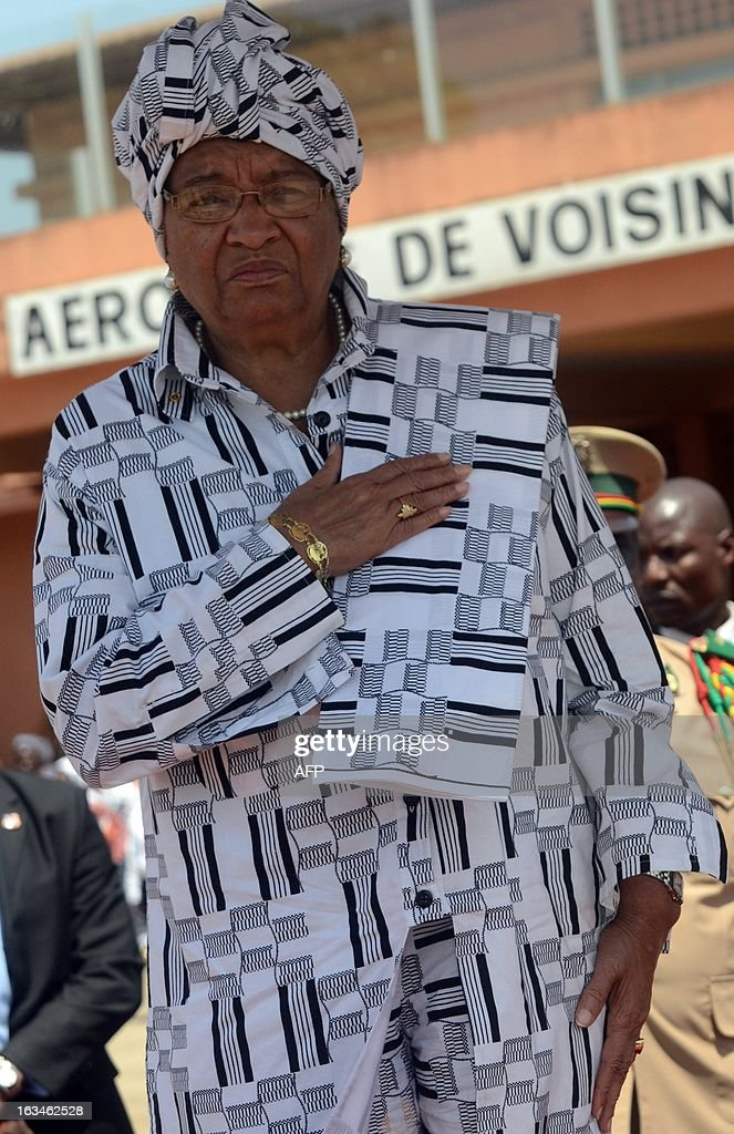President of Liberia Ellen Johnson Sirleaf stands at the Conakry airport on March 10,2013 before a meeting with her counterparts from Guinea, Ivory Coast, and Sierra Leone, as Guinea battles unrest linked to legislative elections in May.