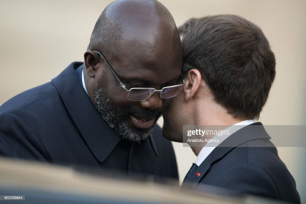 President of Liberia, George Weah (L) leaves Elysee Palace after his meeting with French President Emmanuel Macron (R) in Paris, France on February 21, 2018.