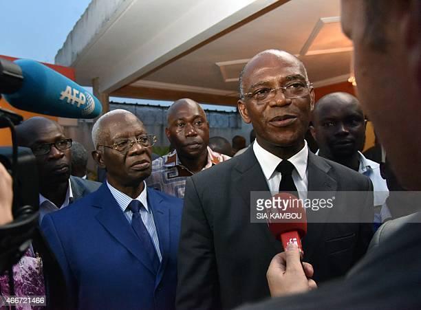 President of Liberté et démocratie pour la République party Mamadou Koulibaly flanked by Aboudramane Sangare of Front Populaire Ivoirien party...