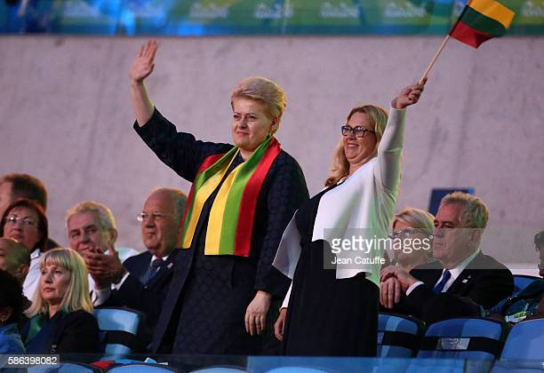 President of Lithuania Dalia Grybauskaite waves to her delegation during the opening ceremony of the 2016 Summer Olympics at Maracana Stadium on...