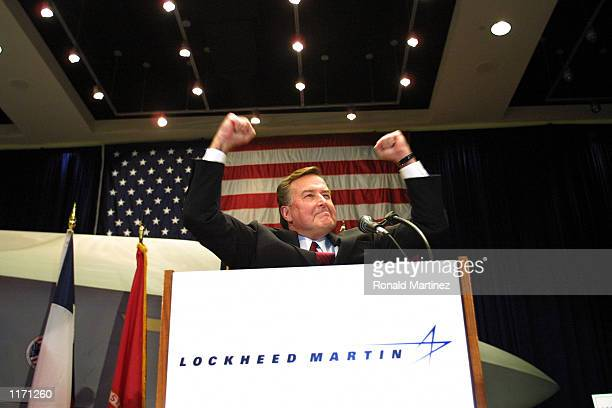 President of Lockheed Martin Aeronautics Company Dain Hancock pumps his fist in the air after it was announced that they won a bid to build the Joint...